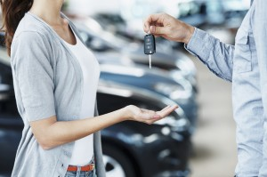 Receiving the keys to her new car